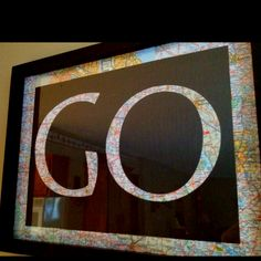 DIY map art - I like this but I would use a world map and use the word go a lot more in different fonts and sizes.. Do it yourself