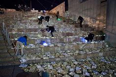"""Literature vs Traffice"" Luz Interruptus installation for ""Light in Winter Festival"" A River of 10,000 Books Overflowed Finders Street in Melbourne ~ Fantastic!!"
