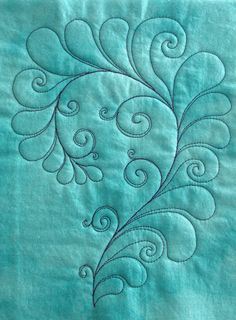 Free motion quilting - feathers & swirls