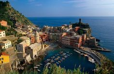 Photo: Village of Vernazza in Cinque Terre, Italy Colorful Vernazza is one of five seaside villages in Cinque Terre National Park. 146 8 4 lise lemay Italia Mia Ellen Vonderheide Thanks for posting the website.....we visited the Cinque Terre in 2004 and it is a beautiful, but fragile place.