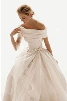 Very beautiful, romantic, Grace Kelly-esque! This would make a great wedding dress with a rose bouquet and roses in the hair.