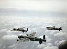 Three Avro Lancaster B Mark Is of No 44 Squadron, Royal Air Force based at Waddington, Lincolnshire, flying above the clouds. Left to right: W4125, `KM-W', being flown by Sergeant Colin Watt, Royal Australian Air Force; W4162,`KM-Y', flown by Pilot Officer T G Hackney, (later killed while serving with No 83 Squadron); and W4187, `KM-S', flown by Pilot Officer J D V S Stephens DFM, who was killed with his crew two nights later during a raid on Wismar.