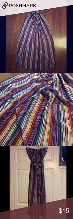 Strapless Rainbow Midi Adorable Rainbow hued asymmetrical maxi with shorter slit front. The fabric is slightly sheer, with the intention of showing the purple mini skirt under (included it in picture). This preloved dress also bring extra fabric to use as ribbon. Agaci Dresses Asymmetrical