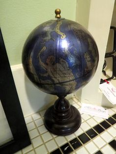 Astrology Globe - $46.50. This desk globe features astrological signs on an indigo background. It's perfect for the office!