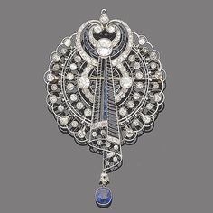An early 20th century sapphire and diamond brooch pendant. Openwork plaque of fine knife-wire, with millegrain set brilliant and single-cut diamonds. Central stylised scroll of diamonds and calibré-cut sapphires, with an oval mixed-cut sapphire drop. Pinned by #Blucha from bonhams.com