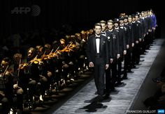 FRANCE, Paris: Models present creations by Dior during the men's Fall/Winter 2015 ready-to-wear collection fashion show on January 24, 2015 in Paris. AFP PHOTO / FRANCOIS GUILLOT