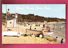 1964 Postcard OF Grand Haven State Park Michigan Beach Scene.  I was there and remember Life Guard stands.  I was 15 years young!  The good old days!