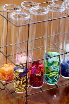 Test tubes hold buttons in an unexpected display.