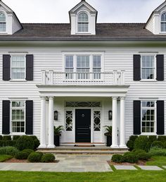 Morgan Harrison Home - Classic colonial style home features black shutters, Doric columns, and a Juliet balcony. Traditional Home Exteriors, Colonial House Exteriors, White Exterior Houses, Colonial Style Homes, White Houses, White Siding, Black Shutters, House With Balcony, Harrison Design