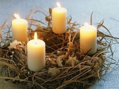 advent wreath with raffia to look like the hay the baby Jesus slept in