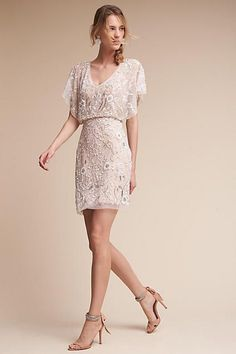 Anthropologie Biltmore Wedding Guest Dress. Part of a special collection from BHLDN. Swirls of beads and sequins add vintage sparkle to the sheer overlay of this blouson cocktail dress. Also noteworthy: a deep v-neck, keyhole back, and and flutter sleeves. By Aidan Mattox #fashion #dress #weddingguest #lace #ad
