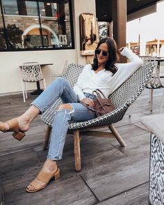 """605 Likes, 21 Comments - Tyler (@girlmeetsgold) on Instagram: """"Am now convinced I need a chair like this at my house. 😅👌🏼free people style, wrap tops, cute summer to fall looks, summer to fall style, classic style, white top and jeans outfit, white tee and jeans outfit, madewell mules, nude block heels, casual style, date night outfit ideas, women's style, womens fashion, fall fashion, cute fall looks, neutral style"""