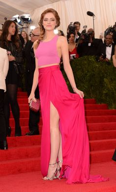 Emma Stone shows off her girly side in two pink pieces by Thakoon at the Met Gala 2014.