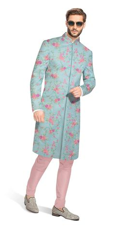 Filipe: The ideal way to add some color to your ethnic wardrobe. The contemporary look of this Sherwani comes from a confluence of French Knots, Satin Stiches and Ari techniques hand embroidered on a Pastel blue matka silk base. This ensemble includes a mauve Churidaar made from pure cotton.