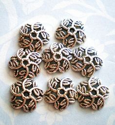 Jewelry bead caps silver swirls 25 by GatheringSplendor on Etsy, $2.25