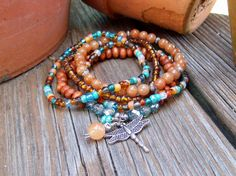 Dragonfly  Beaded Stretch Bohemian Stacker Bracelets   by Angelof2, $26.50. Gorgeous colors. Great beading inspiration.
