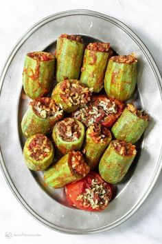 An all-star stuffed zucchini recipe with a special Middle Eastern style filling of spiced rice, ground beef w/ tomatoes & fresh herbs! Step-by-step tutorial