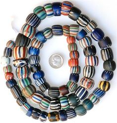 """""""Mixed strand of Aspeo Chevrons and Wound Beads... including large Islamic bead"""" 1200 - 1800 CE, Murano, Italy Picard Bead Museum, Carmel, CA"""