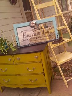 Chartreuse cabinet, rusty yellow ladder shelf, and old window all by Krazy's Kreations in Brady, Tx
