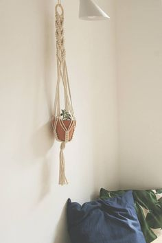 Medium size HANDMADE macrame plant hanger. Made in our studio in Edinburgh, Scotland. // 100% Cotton cord // Natural, un-treated wood Each hanger is hung from a small wooden ring, making it easy to move around and hang from a multiple of fixings. Each item is handmade to