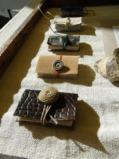 mini mini books as pendants at our last fair/festival of writing and reading handmade paper, of course, hand bound, 60 pages each, leather and hemp covers (second from bottom: manta skin! Paper Book, Paper Art, Paper Crafts, Handmade Journals, Handmade Books, Handmade Notebook, Mini Books, Up Book, Book Art