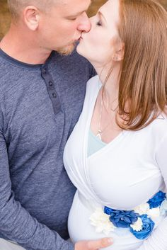 Simply Picturesque Photography, Pennsylvania Maternity and Newborn Photographer, Mom and Dad to be sharing a kiss with Dad to be holding baby bump.