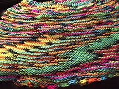 The wickedly awesome texture is created by choosing to knit certain colors as they appear and purling others. In this case I used Back Light and knit whenever the yarn was pink, orange or yellow and purled whenever it was blue or green. Black was neutral, so if it was in a warm run I knit it and it if was in a cool run I purled it and if it was between a warm and cool run I used it for transition. Have fun! Go crazy!