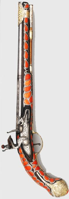 Ottoman (Balkan?) flintlock pistol, 18th century, steel, iron, silver, coral, L. 19 1/2 in. (49.5 cm), Met Museum, Bequest of George C. Stone, 1935.