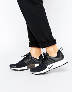Buy it now. Nike Presto Trainers In Black - Black. Trainers by Nike, Breathable mesh upper, Rubberised caged overlay, Lace-up fastening, Shaped cuff, Grosgrain pull tab, Nike Swoosh logo, Contrast sole, Waffle tread, Wipe with a damp cloth. ABOUT NIKE Nike dominates the sportswear industry with a fresh, stylish approach to casual apparel. Super cool trainers and hi-tops lead the bold collection of footwear. Fashion-led collections reference directional detailing, with a punchy, modern colour…