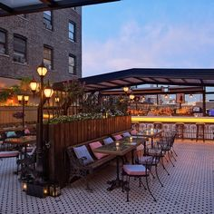 After a long winter, the urban drinkers of this great metropolis can't wait to head outside to imbibe. Fortunately, rooftop bars, nestled high above the clamor of the streets, are plentiful. Here's a list of some of the best. Rooftop Party, Rooftop Terrace, Terrace Garden, Rooftop Lounge, Pallet Bar Stools, New York Rooftop, Vintage Coffee Shops, Backyard Bar, Backyard Ideas