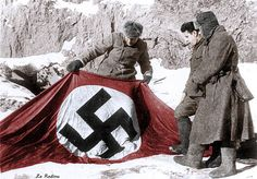 Russian soldiers find this Nazi flag during the Battle of Stalingrad