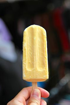 Orange Banana Smoothie Popsicle.  These homemade popsicles are made with Greek Yogurt, so they're a healthy alternative to store-bought ones!  Recipe on Faithful Provisions.com