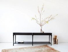 Egg Collective Fern Console Table.  The Fern Console Table has hand-carved hoof-like feet and is available in two standard lengths, 96 inches and 120 inches. Available in blackened white oak (shown), natural white oak, walnut, and bleached maple.  http://www.remodelista.com/posts/heirloom-furniture-from-egg-collective