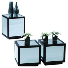 Set of 3 mirrored side tables that can be bunched together to create a coffee table.  Product: 2 Small and 1 large side table