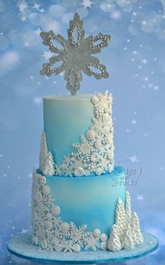 For this cake , I airbrush with blue and pearl sheen , the big snowflake is gumpaste cutout with silver diso and drages… each tier is around 6 inches tall . Torte Frozen, Frozen Doll Cake, Disney Frozen Cake, Frozen Theme Cake, Frozen Birthday Cake, Disney Cakes, Frozen Fondant Cake, Frozen Frozen, Winter Torte