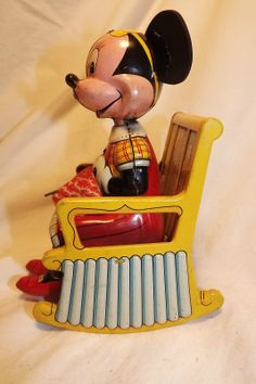 1950's Walt Disney, Minnie Mouse Knitting in Rocker Lithographed Tin Wind-Up Toy