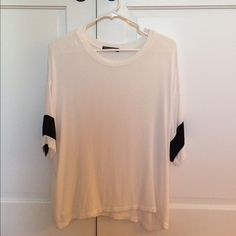 Brandy Melville Jersey Shirt This shirt is in perfect condition; only worn a few times. Super soft and has longer sleeves that go bast elbows. Shirt is a longer fit too, as pictured above. Shirt is one size, but will fit someone who is a small or medium. No trades please! Brandy Melville Tops Tees - Short Sleeve
