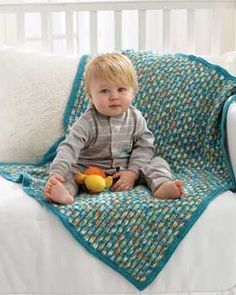 This colorful blanket combines an ombre and a solid shade to create an exciting woven look. Knit in Bernat Baby Sport.