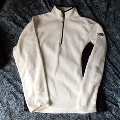 North face white & black pull over! Super soft and warm pullover by north face! Thinner than most pullovers but incredibly warm and fleece-like fabric. Features a zipper by the neck and the logo on the sleeve. Says a women's large but fits more like a small or medium! In perfect condition and only worn a maybe 3 times ❤️NO TRADES❤️   $35 + $6 shipping on merCari, also on vinted North Face Jackets & Coats