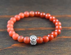 • Opposites Attract! Mens Beaded Bracelet - Carnelian Bracelet - Lion Bracelet - Mens Yoga Bracelet - Mens Fashion - Lotus & Lava Bracelet • • Known as a stone of leadership & courage, Carnelians have protected & inspired throughout history. It enables the wearer to look at the bright side of life; helping to maintain a feeling of optimism & happiness.