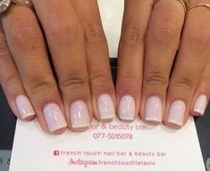 French gel manicure with a light pink base and thin white tips