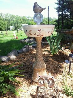 """Bird bath I made with repurposed glass.  """"Berry Basket."""" made by Laurie Flaherty."""