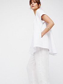 Cool Like Courtney Buttondown | The classic buttondown gets a cool, modern update with this femme take on a structured style.  Collar-inspired neckline with a skin-baring open back.    * Front button closures   * Lightweight, semi-sheer