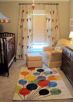How to design a gender neutral circus theme baby room using colorful vintage style decor.