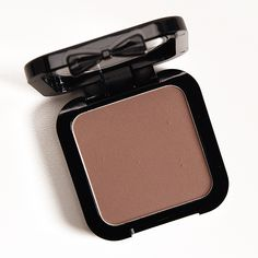 NYX Taupe HD Blush NYX Taupe HD Blush ($6.50 for 0.16 oz.) is a medium-dark, taupe brown with subtle warm undertones and a semi-matte finish. Kat Von D Som