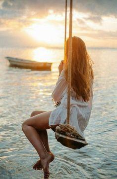 Girl on swings.