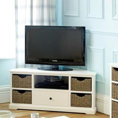 Could put baskets on shelves to dress up IKEA units like this: Cottage Ivory Corner TV Unit | Dunelm Mill