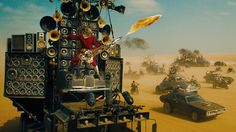 That Insane 'Mad Max' Flame-Throwing Guitar Is No CGI Trick -- Here's How They Actually Made It - MTV