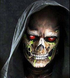 Painting your lids black and red is the coup de grâce with this skull makeup. If you can have a friend draw or stencil a skull face on you, all you have to do is dress in black and wear a hoodie, and you've got an amazing costume. Photo courtesy Lynne Jamieson