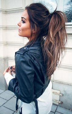 ponytail. belted leather jacket.